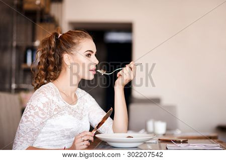 Beautiful Woman 20-24 Year Old Eating In Cafe. 20s.