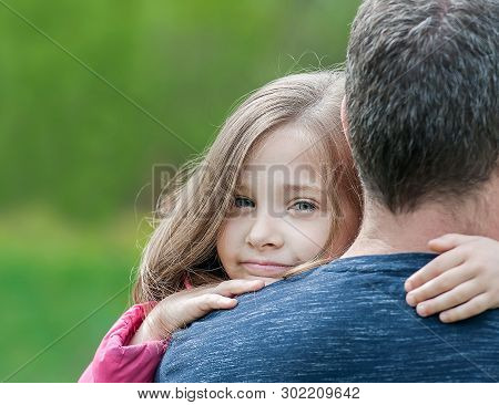 Portrait Of Cute Little Girl Held In Father Arms. Happy Loving Family. Father And His Daughter Child