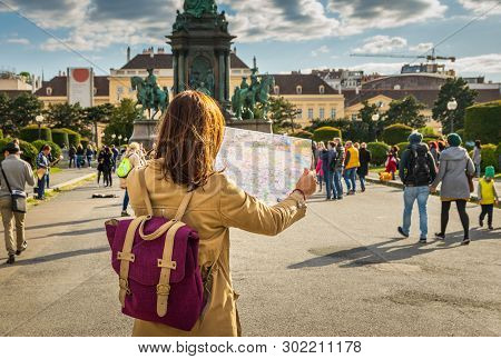 Traveler Girl With Map In Vacation. Young Traveler Girl In Vacation. Girl Traveling Alone With Map I