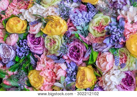 Background Of Pink And Yellow Paper Flowers. Artificial Flowers. Floral Background.