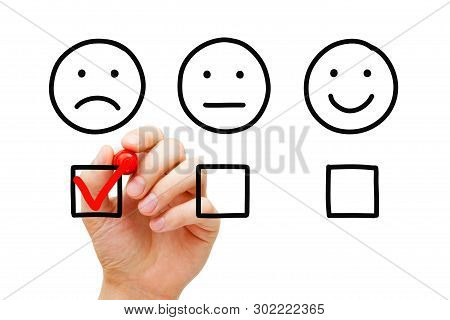 Disappointed Client Leaving Negative Evaluation With Red Marker Check Mark On Customer Feedback Surv