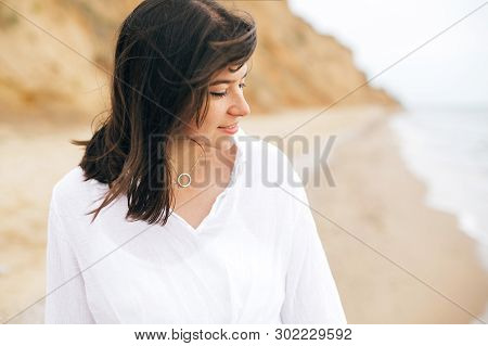 Stylish Hipster Girl Relaxing On Beach. Summer Vacation. Portrait Of  Happy Boho Woman Enjoying Time