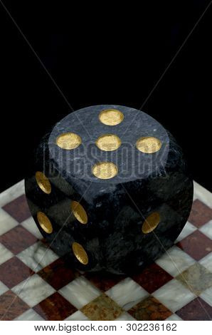 Gambling Against Top - Dice On Marble Chessboard.
