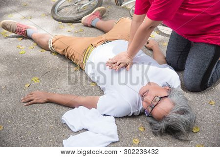 Hand Of Asian Woman First Aid Emergency Cpr On Heart Attack Senior Senior Man With Cardiac Arrest Wh