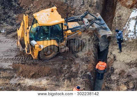 Excavator Works Near Trench On Construction Site