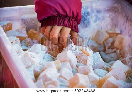 Childs Hand Takes Turkish Delight Lokum With Powdered Sugar