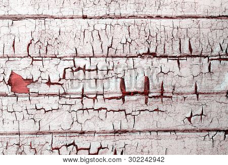 Old Weathered Wooden Plank Painted In Red Pink Color
