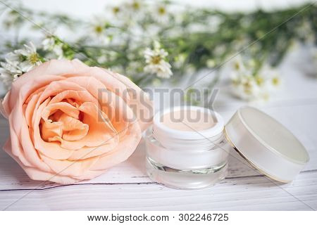 Skin Care Concept. Product Of Pink Skincare Remedies Cream In Package With Blank Label With Big Pink