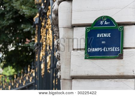 Champs Elysees Street Sign On A Pillar