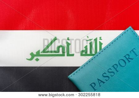 On The Flag Of Iraq Is A Passport. The Concept Of Travel And Tourism.