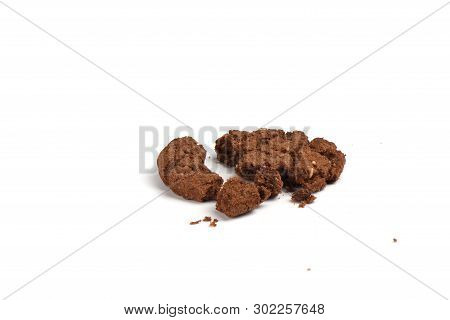 Crumbled Granola Cookies With Chocolate And Hazelnuts Isolated On White Background.