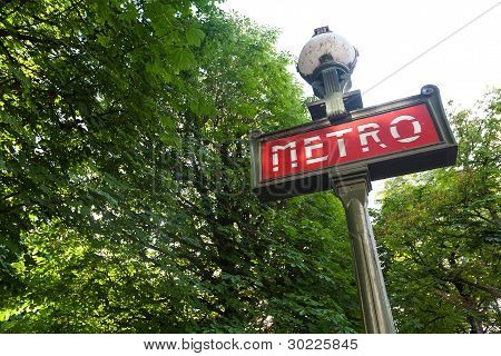 Paris Metro Sign In A Park Setting