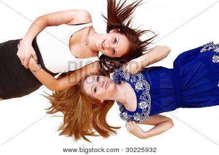 Two Girlslying On Floor.