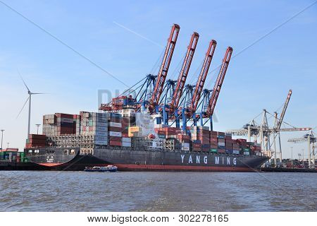 Hamburg, Germany - August 28, 2014: Container Ship Loading At Port Of Hamburg In Germany. The Seapor