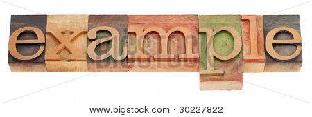example  word in vintage wood letterpress printing blocks, stained by color inks, isolated on white