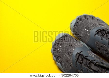 One Sport Gray Sneakers On Yellow Background