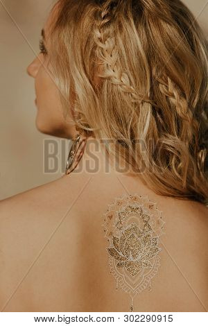 Portrait Of A Beautiful Blonde Woman From The Back On A Desert Background. Light Sand, Stylish Acces