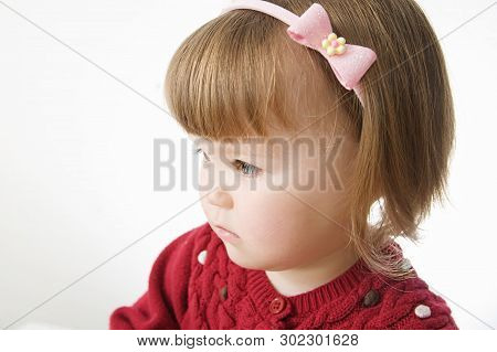 Little Girl Portrait. Cute Caucasian Baby Bob Hairstyle With Rim