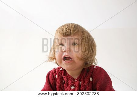 Scared Little Girl Smiling Happy. Cute Caucasian Baby