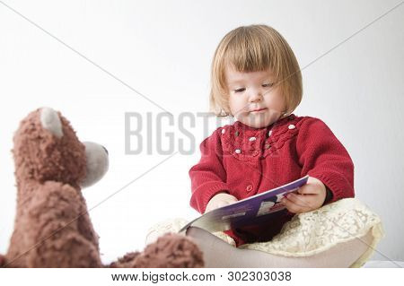 Story Time. Little Girl Playing School With Toys Teddy Bear And Doll.  Children Education And Develo