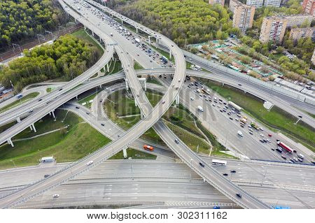 Aerial View Of Road Junction In Moscow From Above, Automobile Traffic And Jam Of Many Cars, Road Jun