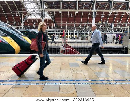 PADDINGTON, LONDON - MAY 20, 2019: Passengers inside Paddington TrainStation, a major railway terminus for journeys to and from the West, in London, UK.