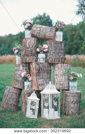 Rustic Wedding Photo Zone. Hand Made Wedding Decorations Includes Photo Booth, Wooden Barrels And Bo