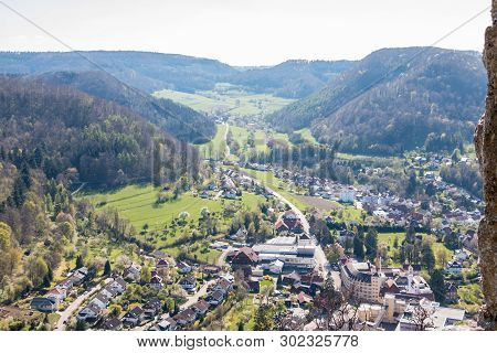 Little Village In The Middle Of The German Countryside With Hills, Forests, Fields And Meadows And T