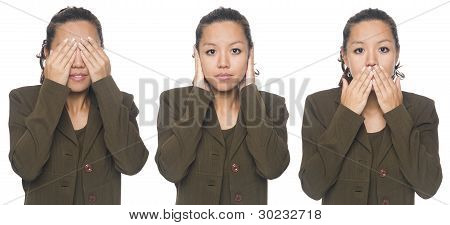 Isolated studio shot of a businesswoman in the See No Evil Hear No Evil Speak No Evil poses. poster