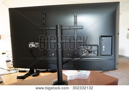 Baltimore, Maryland - May 14, 2019: Back View Of A Modern Lg Flatscreen Hdtv, Showing Cables, Plugs,