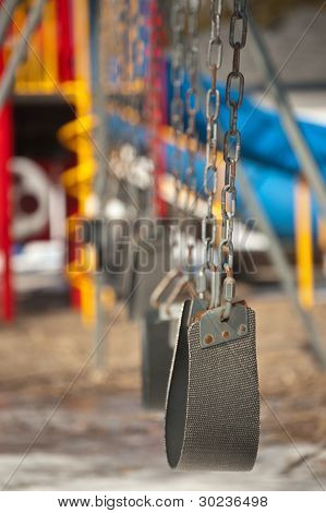 Empty Swings In A Playground