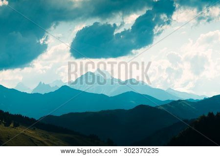 Landscape with beauty blue mountains range and cloudy sky