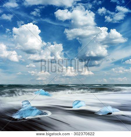 Blue Iceberg pieces on Diamond beach near Jokulsarlon lagoon, Iceland. Landscape photography