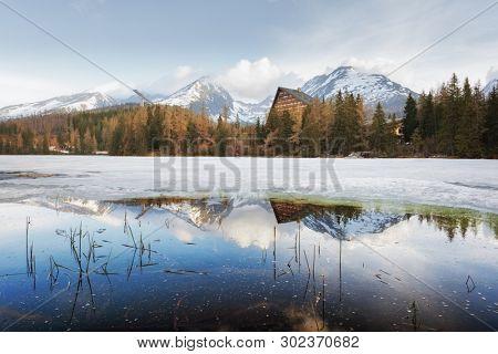 Mountain lake Strbske pleso (Strbske lake) in spring time. High Tatras national park, Slovakia. Landscape photography