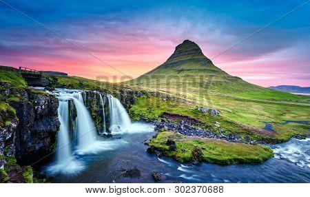 Picturesque landscape with Kirkjufellsfoss waterfall and Kirkjufell mountain, Iceland, Europe.