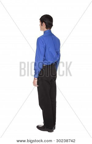 Caucasian Businessman Standing With Arms At Sides Rear View