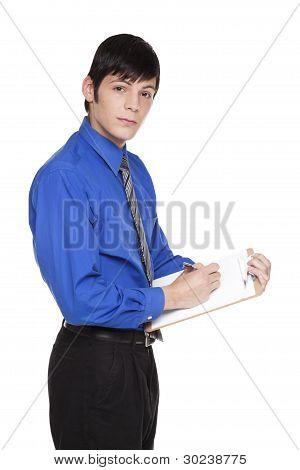 Caucasian Businessman Writing On Blank Clipboard