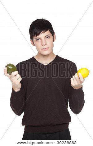 Caucasian Man Comparing Lime To Lemon
