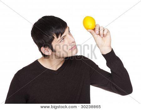 Caucasian Man Examining A Lemon
