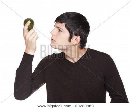 Caucasian Man Examining A Lime