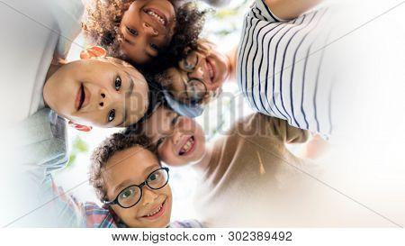 Happy kids huddling in the park