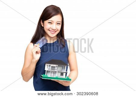 Happy Asian Woman Holding Credit Card And Home Loan, Planning To Take On A Large Loan For Big Purcha