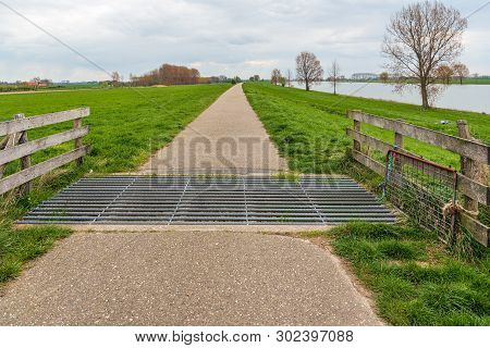Cattle Grid In A Narrow Cycle And Walking Path Along A River In The Netherlands. The Photo Was Taken