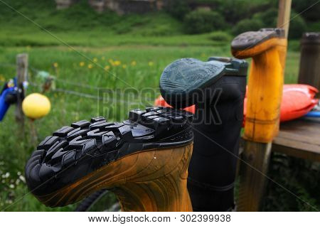 Isle Of Skye, Scotland - 11th June 2014 : View Of Some Wellies Placed On Some Wooden Poles During A