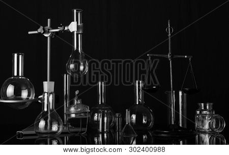 Chemical Laboratory A Variety Of Laboratory Flasks And Test Tubes, Chemical Scales And The Burner. B