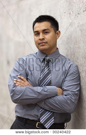 Hispanic Businessman - leaning on wall