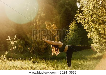 Beautiful Plus Size Girl Doing Yoga In Nature On A Sunny Summer Day. Body Positive, Sports For Women