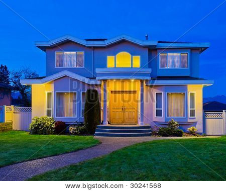 Luxury house at dusk in Vancouver, Canada.