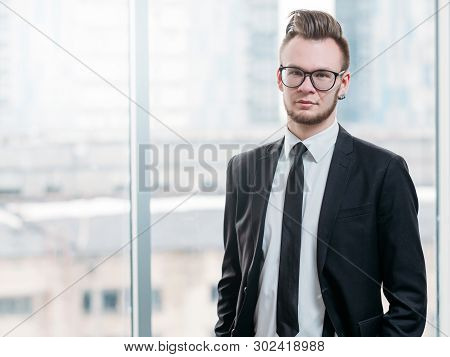 Successful Business Man With Ambitious Attitude. Portrait Of Confident Young Leader Standing In Mode