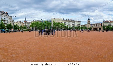 Lyon, France - May 09, 2019: Scene Of Place Bellecour Square, With Locals And Visitors, In Lyon, Fra
